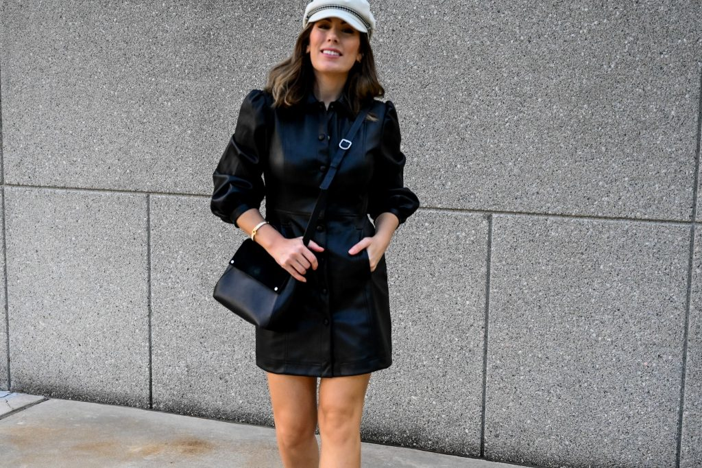 Houston-based style blogger Maria Munoz of Bella Style Living shares how to style a vegan leather dress for fall