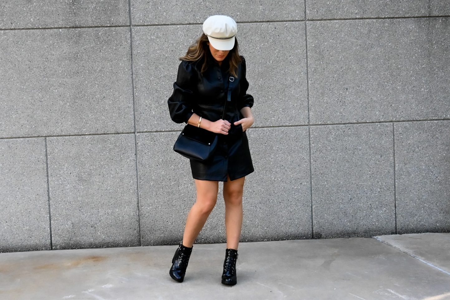 Top Houston fashion blogger Maria Munoz shares how to style a faux leather shirt dress from Topshop