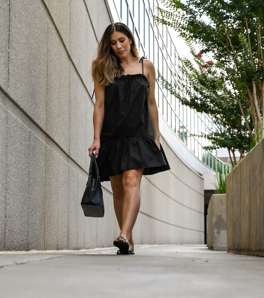 Houston lifestyle blogger Maria Munoz in Revolve black dress