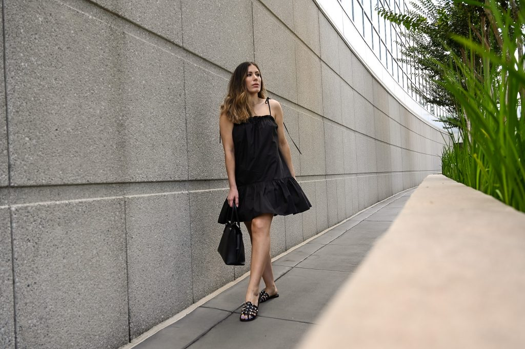 black summer dress with thin ties at the shoulder from Revolve