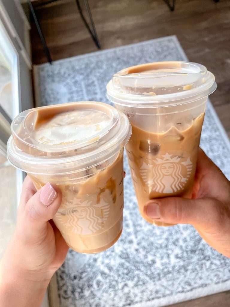 Two Starbucks drinks in hand