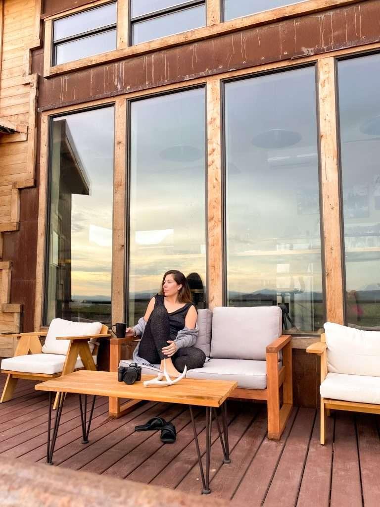 Houston lifestyle blogger Maria Munoz sitting on porch in Boca de la Roca